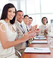 Multi-ethnic business team applauding after a conference