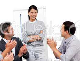 Asian businesswoman applauded for her presentation