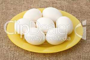 White eggs on a plate