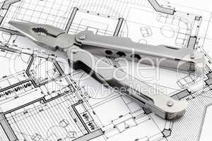 pliers and architectural plan