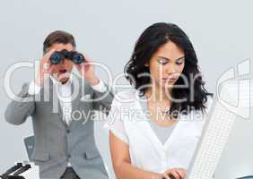 Charismatic businessman looking his colleague's computer through