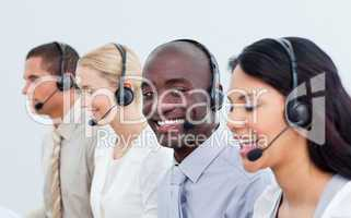Ethnic man and his team working in a call center