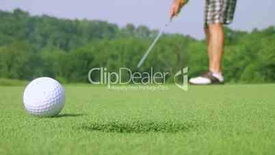 Golfer Sinks Putt 03