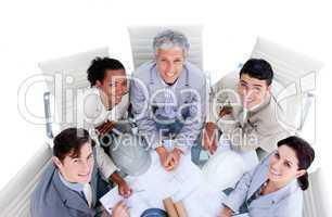 Happy international architects studying blueprints