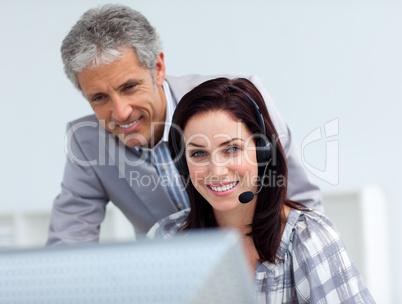 Senior manager checking his employee's work