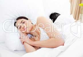 Worried woman lying in her bed