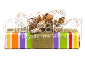 Gift box with golden bow on a white background