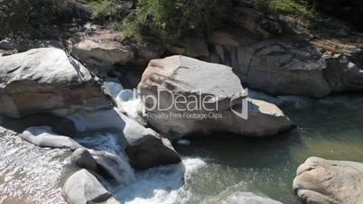 Rock diver into river
