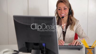 female receptionist working on computer
