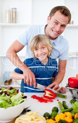 Cheerful father and his son cooking