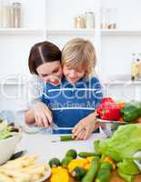 Happy mother and her son cooking