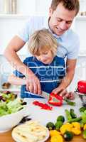 Jolly father and his son cooking