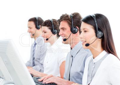 Joyful customer service agents working in a call center