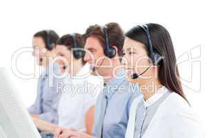 Cheerful customer service agents working in a call center