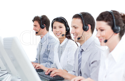 Multi-cultural customer service agents working in a call center