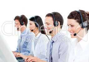 Smiling customer service agents working in a call center