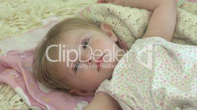 Cute baby falls asleep