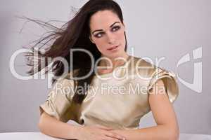 young pretty woman weraing gold fashion dress - portrait