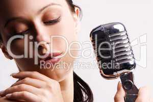 Sexy woman singing in retro mic