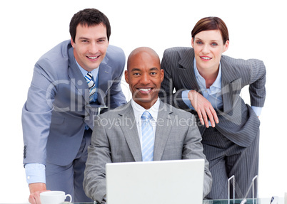 Positive business co-workers using a laptop