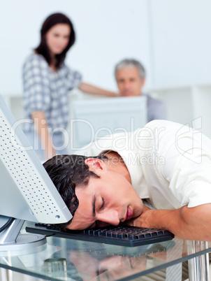 Tired businessman sleeping on his keyboard