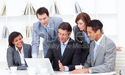 Serious multi-ethnic business partners working at a laptop