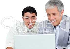Assertive business co-workers using a laptop