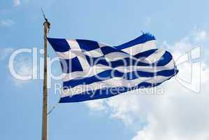 Waving flag of Greece against the blue sky