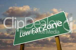 Low Fat Zone Green Road Sign and Clouds