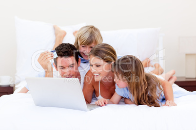 Animated family buying online lying down on bed