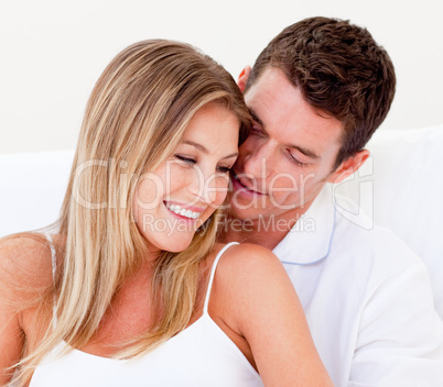 Portrait of an affectionate couple sitting on bed