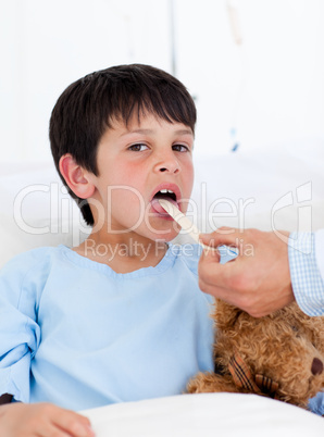 Adorable little boy attending medical exam