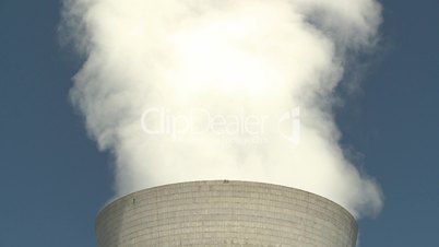 steam rises from a large chimney