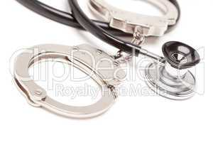 Stethoscope and Handcuffs on White