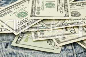 US dollar banknotes and jeans