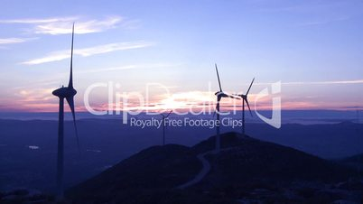 Wind turbine in the mountains at sunrise