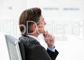 Pensive male executive sitting in his office