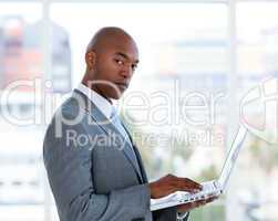 Portrait of a confident businessman working at a laptop