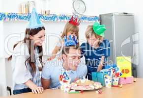 Elegant man celebrating his birthday with his wife and his child