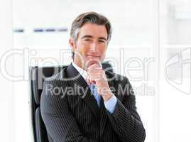 Ambitious male executive sitting in his office