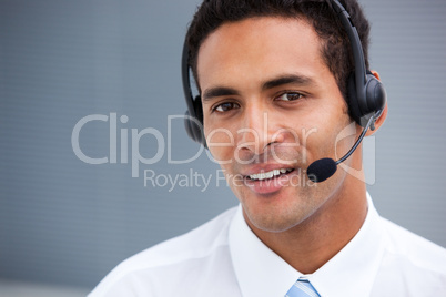 Portrait of a handsome customer service agent at work