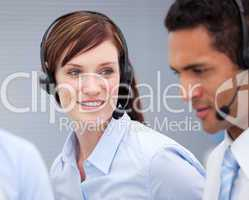Close-up of a female customer service agent and hercolleague