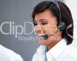 Portrait of a laughing customer service agent at work