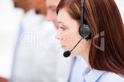 Close-up of a female customer service agent and her team