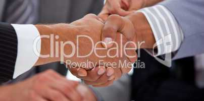 Close-up of two businessmen closing a deal