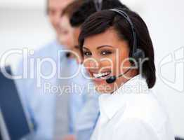 Close-up of an ethnic customer service agent and her team