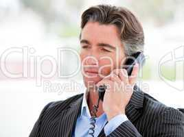 Portrait of a self-assured businessman on phone