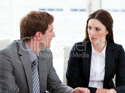 Two concentrated business people talking together