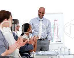 Ethnic businessman presenting statistics in a company