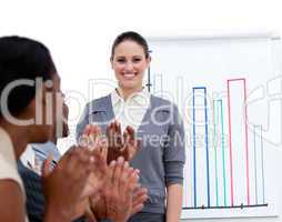 Smiling businesswoman presenting statistics in a company
